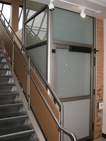 Genesis enclosure vertical wheelchair lift garaventa for Www garaventalift com