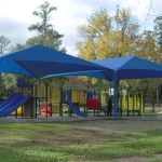 Hendee Enterprises Inc. - Hip & Ridge Fabric Shade Structures