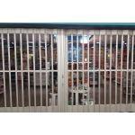 Overhead Door Corporation - Side Folding Full Enclosure Security Grilles 677